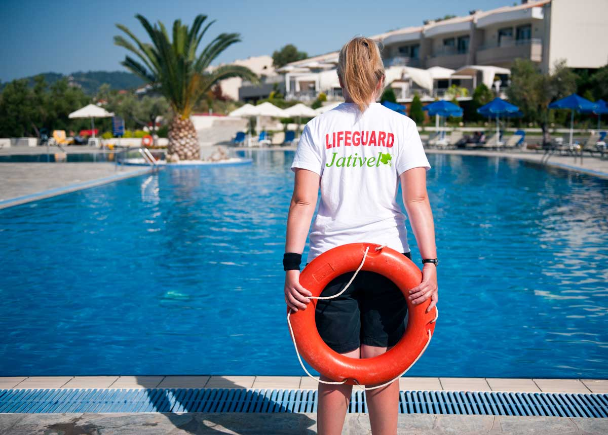 Female lifeguard on duty at a swimming pool